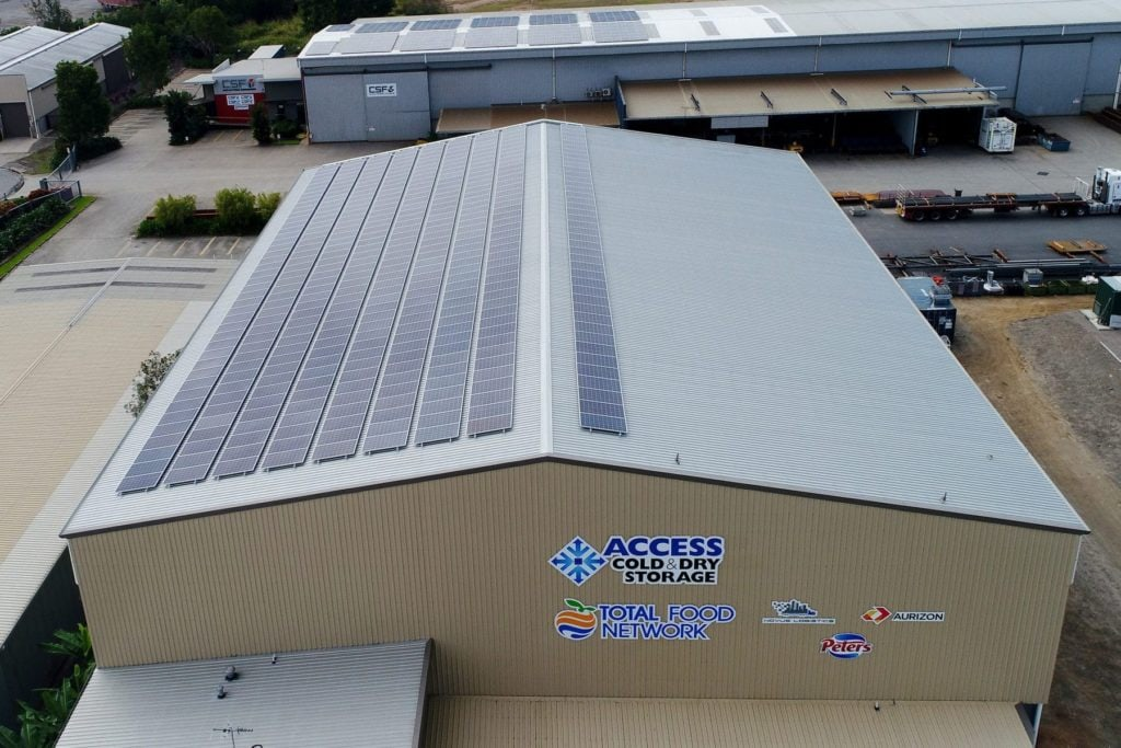 solar panels on the roof of a cold storage facility