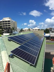 solar panels on the roof of a commercial building