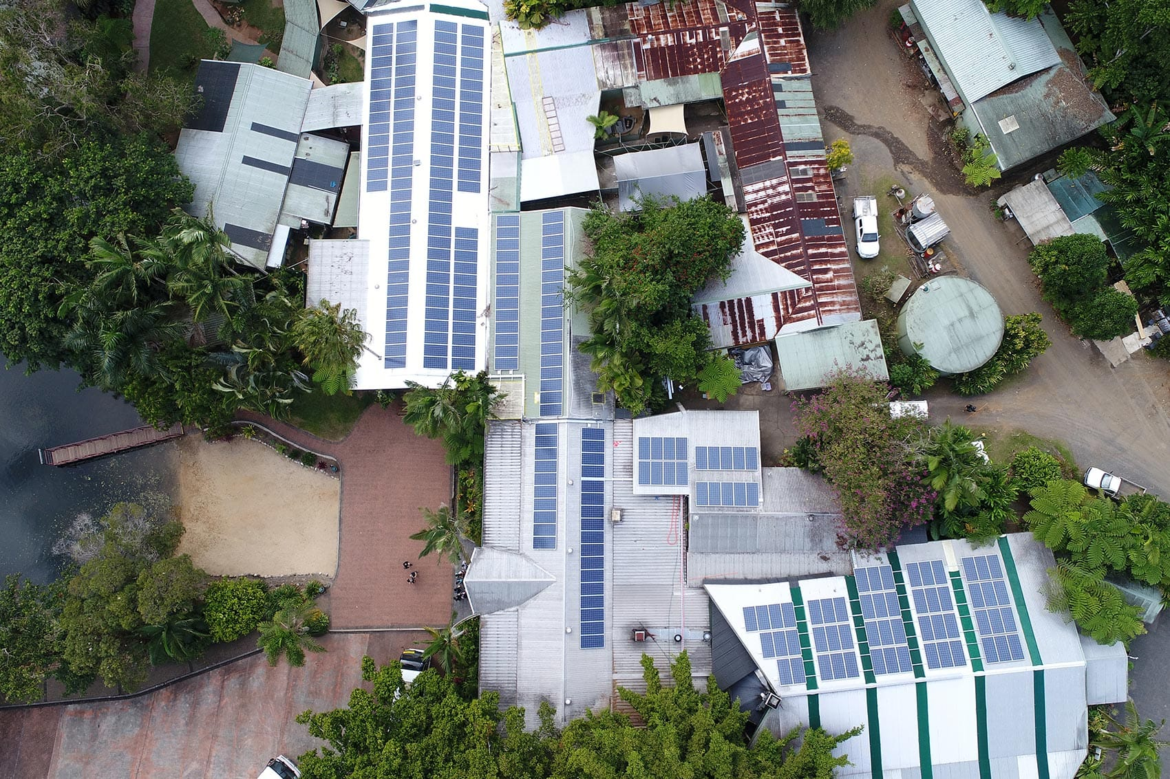 rows of solar panels on roofs
