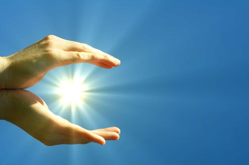 hands sun and blue sky